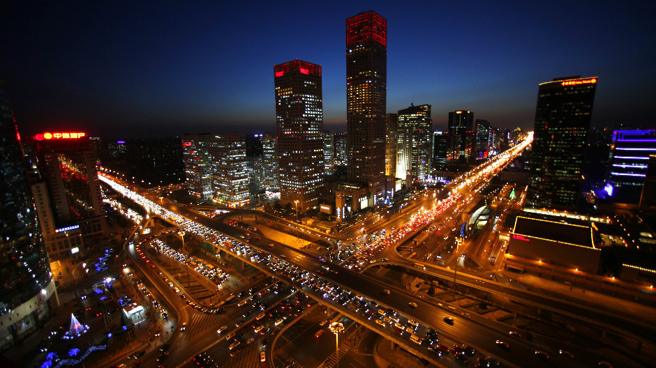 Vehicles drive on Three Ring Road (left) and Jianwai Street (right) during the evening rush hour in central Beijing, December 23, 2010. Beijing will limit issuance of new car plates to 240,000 annually from January 1, 2011, in an effort to ease the capital city's traffic jams, Xinhua News Agency reported.